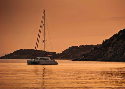 Crewed Sailing Yacht Catamaran at sunset