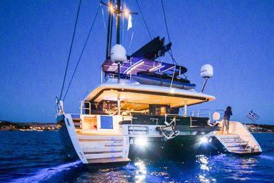 Nigel James Yacht Charter crewed catamaran CARPE DIEM at sunset