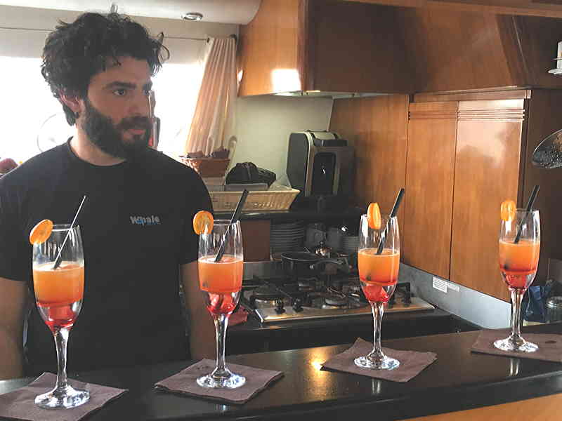 The skipper of crewed catamaran Whale as barman