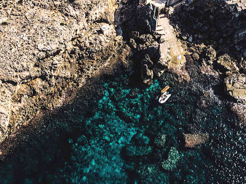 Aerial shot of rocky Mediterranean shore with crystal clear sea